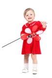 Den förtjusande ljusa ståenden av att spela behandla som ett barn flickan med den röda leksaken Fotografering för Bildbyråer