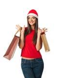 Den förvånade härliga flickan prissätter julförsäljningar Arkivfoto