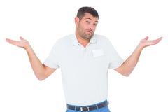 Den förvirrade teknikeren som ger sig vet jag, inte gest Arkivfoton