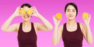 Den fastst?llda asiatiska flickan med h?rlig klar hud rymmer frukter p? purpurf?rgad bakgrund - h?lso- och viktf?rlustbegreppet arkivbild