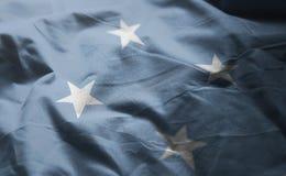 Den Federated States of Micronesia flaggan rufsade till upp nära royaltyfri bild