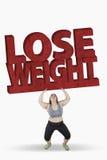 Den feta kvinnan med förlorar vikttext Arkivfoto