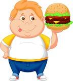 Den feta pojketecknade filmen som ler och, ordnar till för att äta en stor hamburgare Arkivfoto