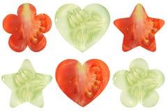 Den formade stjärnan, hjärta formade, och blomman formade halvor av grönsaker Arkivbild
