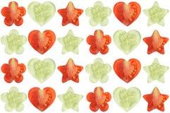 Den formade stjärnan, hjärta formade, och blomman formade halvor av grönsaker Arkivfoton