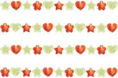 Den formade stjärnan, hjärta formade, och blomman formade halvor av grönsaker Royaltyfri Bild