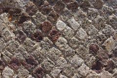 Den forntida masonryen av de diamond-shaped tegelstenarna Fotografering för Bildbyråer