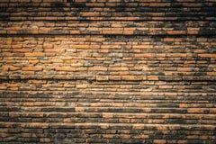 Den forntida tegelstenväggen texturerar Royaltyfri Foto