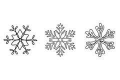 Den fortlöpande linjen teckning ställde in av snöflingor, vintertema stock illustrationer