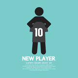 Den fotboll-/fotbollspelaren som visar en skjorta Arkivfoto