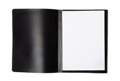 Den främre sikten av mappen för den öppna mappen med tomt papper täcker arkivfoto