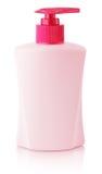 Den främre sikten av stelnar, skum eller flaskan för pump för utmatare för vätsketvål som den rosa plast- isoleras på vit Royaltyfria Bilder