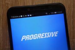 Den Framstegsvän Korporation logoen visade på en modern smartphone royaltyfria foton