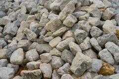 Den fulla bilden av vaggar, stenar för konstruktion Arkivfoton