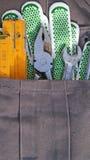 Den funktionsdugliga handsken och bearbetar Fotografering för Bildbyråer