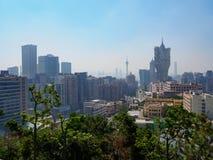 Den futuristiska horisonten av Macao under dagen royaltyfri fotografi