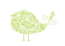 den fyllda fågelecoen går den gröna teckensilhouetten Arkivfoton