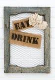 Den gamla bildramen med äter och dricker etiketter Royaltyfri Fotografi