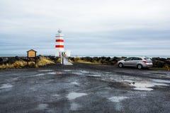 Den gamla fyren i Gardur, Island härliga brobyggnader brukar liggande för den iceland lagarfljotlaken Atlantic Ocean övre sikt royaltyfri bild