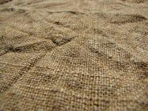 Den gamla och naturliga säckväven Rynkig kanfas Arkivbild