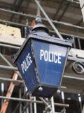 Den gamla polisen undertecknar Arkivfoton