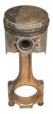 Den gamla rostiga pistongen med en stång som isoleras på en vit bakgrund Royaltyfri Fotografi