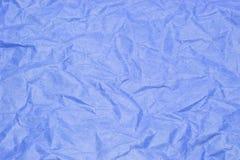 Den gamla skrynkliga för texturmodell för blått papper bakgrunden för abstrakt begrepp Arkivfoton