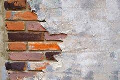 Den gamla tegelstenväggen är bruten, bakgrund Arkivbild