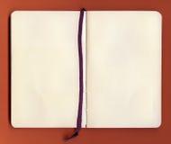 den gammala antika boken öppnar Arkivfoto
