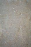 Den gammala grå färgbetongväggen texturerar Arkivbild