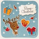 Den glade julkortet med behandla som ett barn hjortar Royaltyfria Bilder
