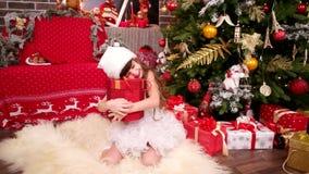 Den glade och lyckliga lilla flickan mottog gåvan från Santa Claus, rum för ` s för nytt år med julgranen arkivfilmer