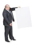 Den gladlynt överviktiga manen med ett tomt undertecknar Arkivbilder