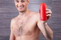 Den gladlynta grabben annonserar produkten för håromsorg Royaltyfri Bild