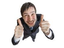 Den gladlynta och lyckliga mannen visar att tummar gör en gest upp bakgrund isolerad white Royaltyfria Foton