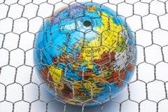 Den globala översikten bak ett trådstaket Fotografering för Bildbyråer