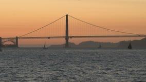 Den Golden gate bridge solnedgången, San Francisco lager videofilmer