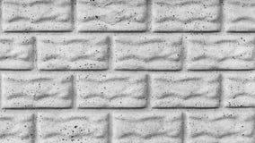 Den gråa texturen av en betongvägg med sprickor, efterföljd av stenkvarter eller tegelstenar, abstrakt bakgrund för arkitektur arkivfoton