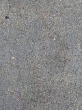 Den gråa väggtexturbakgrunden arkivbild