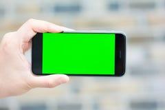 Den gröna och tomma skärmen av den smarta telefonen Fotografering för Bildbyråer