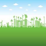 Den gröna staden eller går gräsplan eller sparar jordbegrepp Royaltyfri Bild