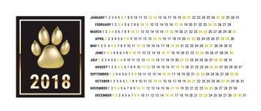 Den grafiska kalendern för 2018 nya år med hunden tafsar vektor Vit bakgrund Arkivfoto