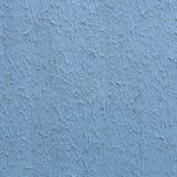 Den grova stuckaturen texturerade bakgrund av en vägg med naturligt ljus Abstrakt textur av murbruk Arkivbild