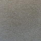 Den grova stuckaturen texturerade bakgrund av en vägg med naturligt ljus Abstrakt textur av murbruk Royaltyfria Bilder