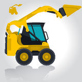 Den gula lilla grävaren laddar byggnadsmaterial Royaltyfria Foton