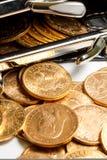 Den guld- amerikanen myntar. Fotografering för Bildbyråer