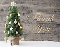Den guld- dekorerade julgranen, text tackar dig Arkivbild