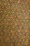 Den guld- forntida väggen på den Narai slotten Arkivfoto