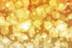 Den guld- gnistrandet tänder bakgrund Royaltyfri Fotografi