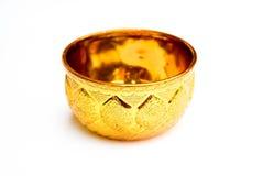 Den guld- koppen är den nätta godan Royaltyfria Bilder